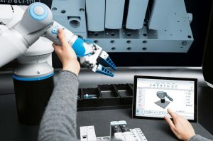 A Man programming the Cobot.